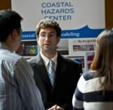 Research Associate Dylan Sandler discusses CHC research with legislative staffers.