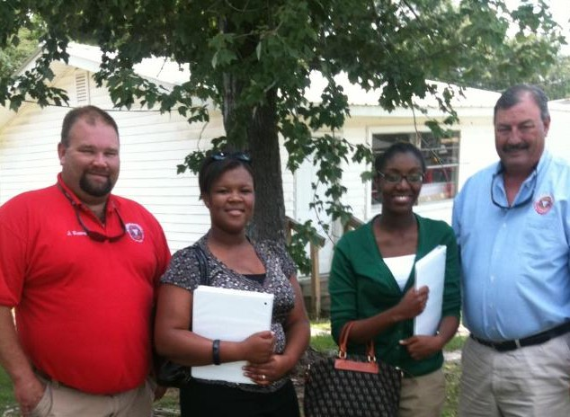 From left to right: Hancock County, MS Emergency Management Deputy John Albert, Tougaloo College student researchers Roshae Wilson and Charden Virgil, Emergency Management Director Brian Adam